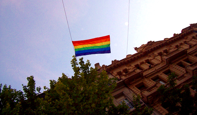 gay pride flag hanging from Argentinian building in Buenos Aires