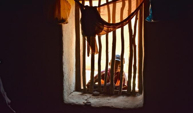A boy looking through a window
