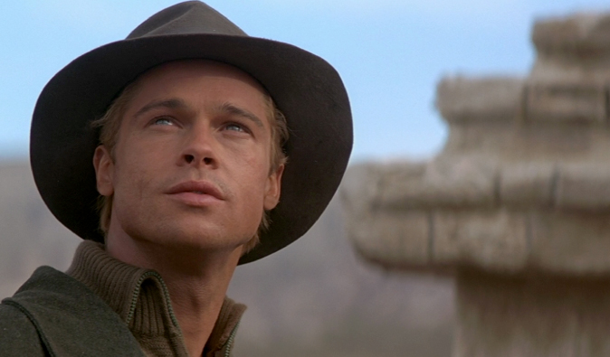 Brad Pitt in a hat in Tibet staring from the 7 Years in Tibet film
