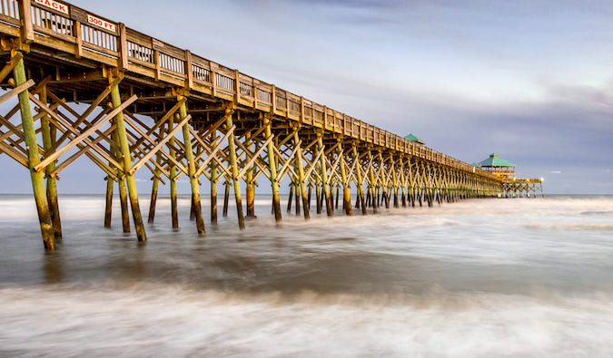 Folly beach pier sunset by Laurence Norah