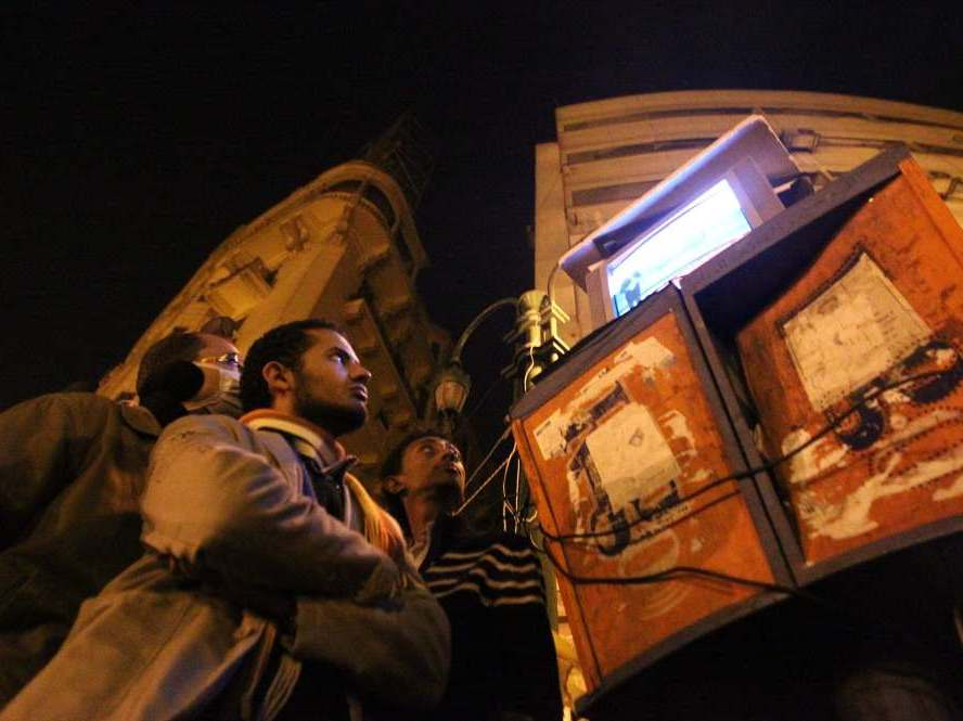 Egyptians gathering to watch Al-Jazeera satellite television station in Cairo's Tahrir Square, following a day of protests calling for the removal of President Hosni Mubarak's regime. Many contend that the network provides the best coverage of the Egyptian protests.