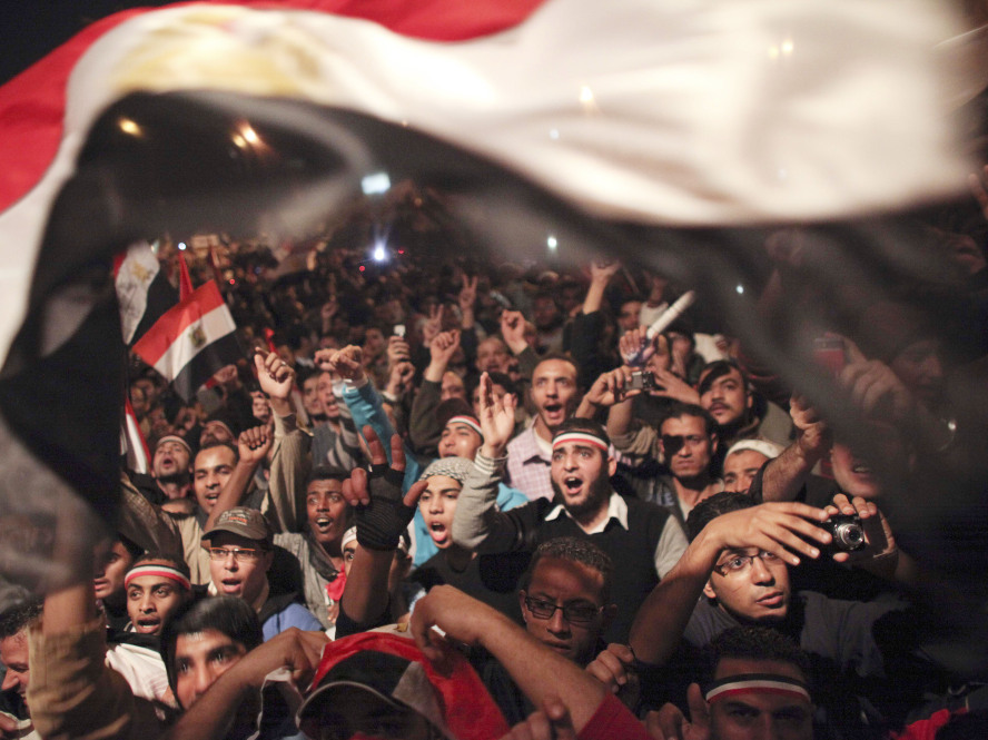 In this file photo, Egyptians celebrate the news of the resignation of Egyptian President Hosni Mubarak on Feb. 11 in Tahrir Square.