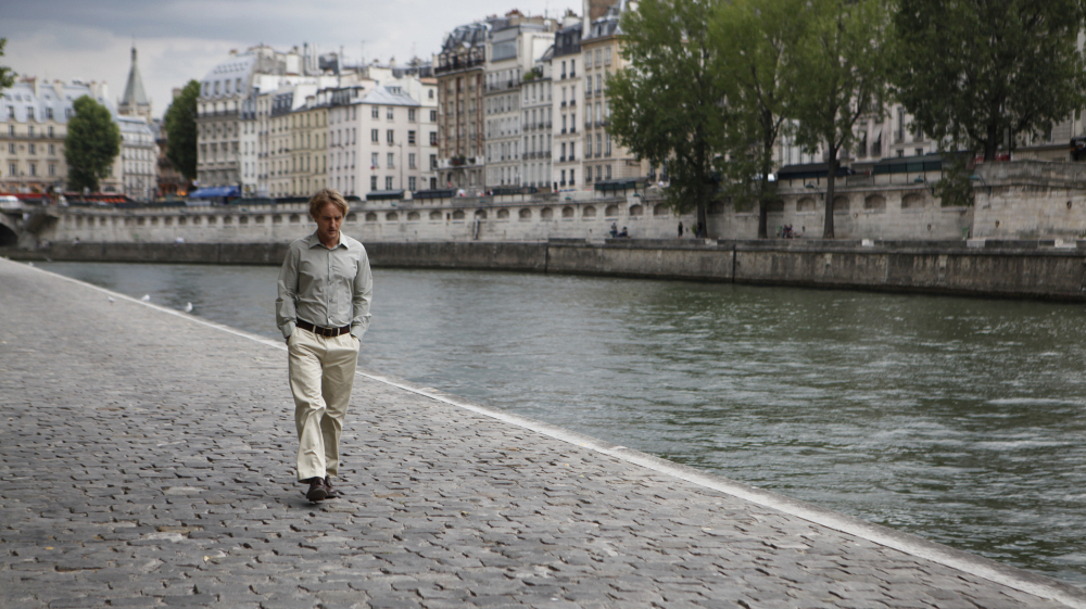 Owen Wilson plays Gil, a Hollywood screenwriter on vacation in Paris who wishes he could escape back to the 1920s. David Edelstein says his performance is one of the finest by a lead in a Woody Allen film — and rivals many of Allen's performances, too.