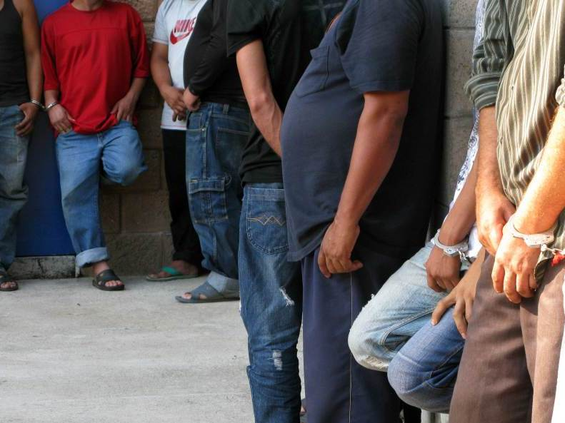 Suspected members of the Mara Salvatrucha gang under arrest at a San Salvador police station.  The 24 suspects were arrested in a police raid. Police officials say they're accused of major crimes including homicide, rape, extortion and drug possession.