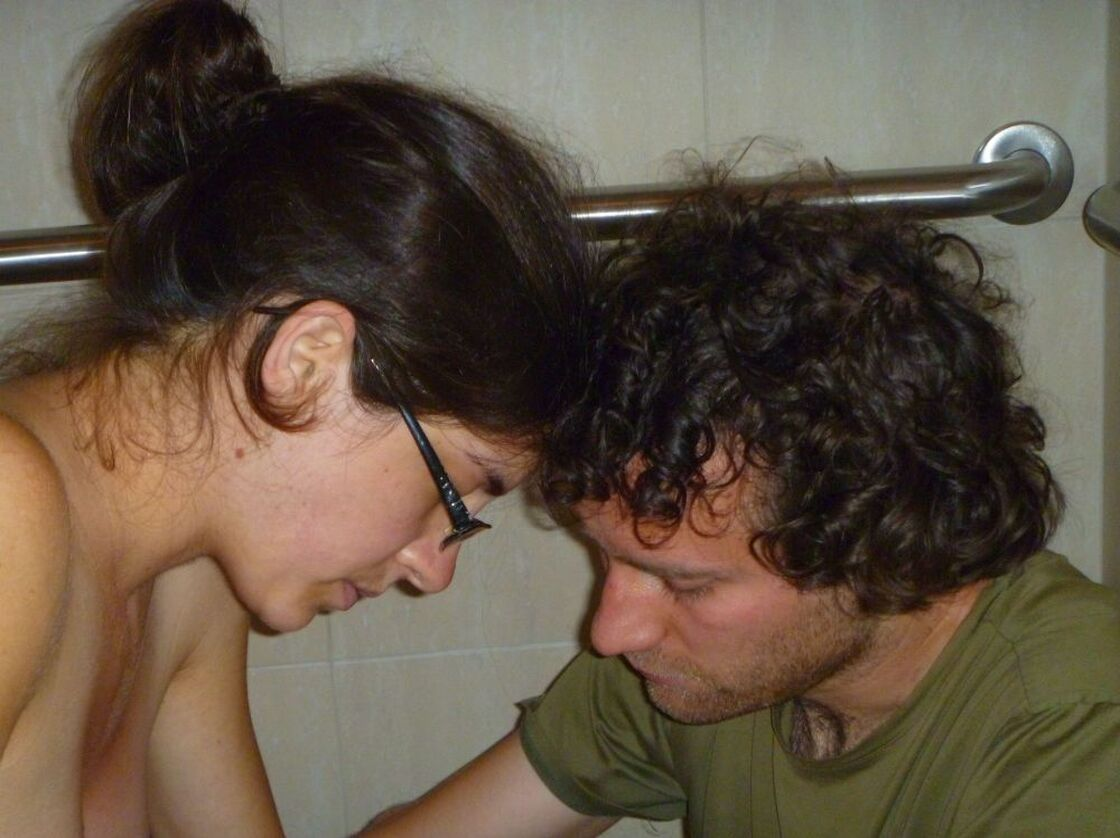 Emily labors in the bathroom of the birthing center with her partner Kai, before the birth of their daughter, Revira.