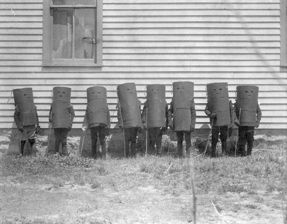 A group of children in cylinder costumes? Possibly for Halloween or a play in Oakley, Kans., 1907