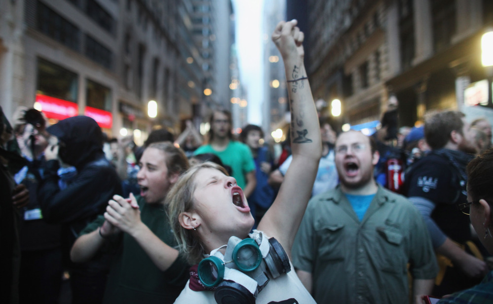 Demonstrators associated with the Occupy Wall Street movement face off with police Friday in the streets of New York City's financial district.