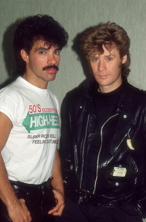 John Oates (left) and Daryl Hall (right) of pop duo Hall & Oates, seen here in 1987. These days, they're available on your phone.