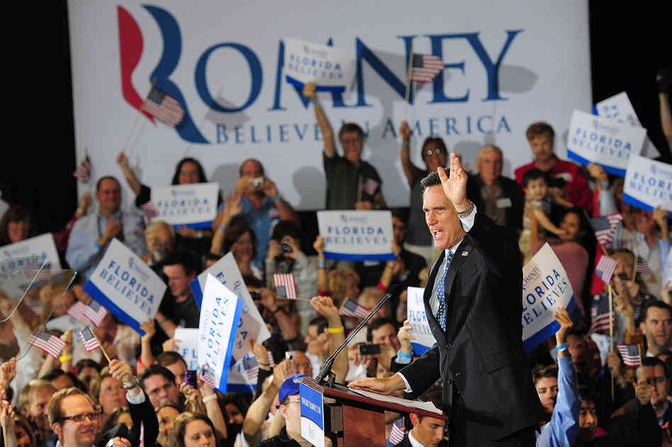 Mitt Romney celebrates after wining the Florida GOP primary by a wide margin over second-place rival Newt Gingrich.