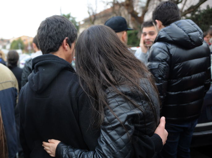 Outside the Ozar Hatorah Jewish school in Toulouse, France, today, onlookers comforted each other after a gunman killed at least four people.