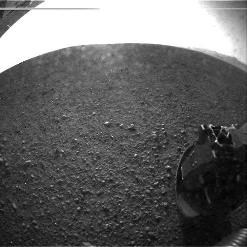 """This is one of the first images taken by NASA's Curiosity rover, which landed on Mars early Monday. It was taken through a wide-angle lens on the left """"eye"""" of a stereo pair of Hazard-Avoidance cameras. Larger color images from other cameras are expected later in the week when the rover's mast, carrying high-resolution cameras, is deployed."""