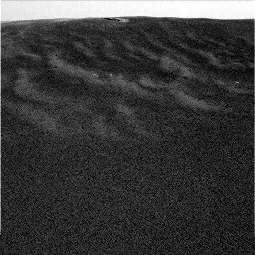 This image shows one of Opportunity's first views of the Martian soil after its successful landing at Meridiani Planum, 2004.