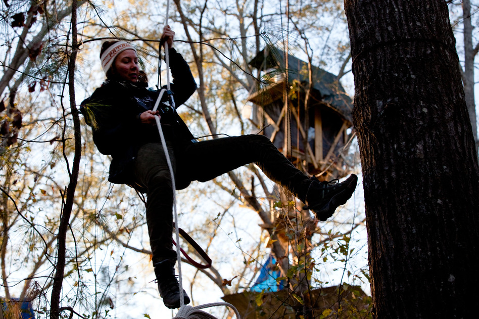 Grace Cagle, a 22-year-old protester, rappels down from the tree village. She spent a total of 17 days in the trees and was arrested once, and spent the night in jail.