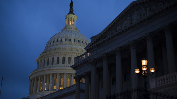 "The Capitol is illuminated in Washington, where the House and Senate remain in session. The two chambers will miss a deadline to avoid the ""fiscal cliff"" tonight, as 2013 begins."