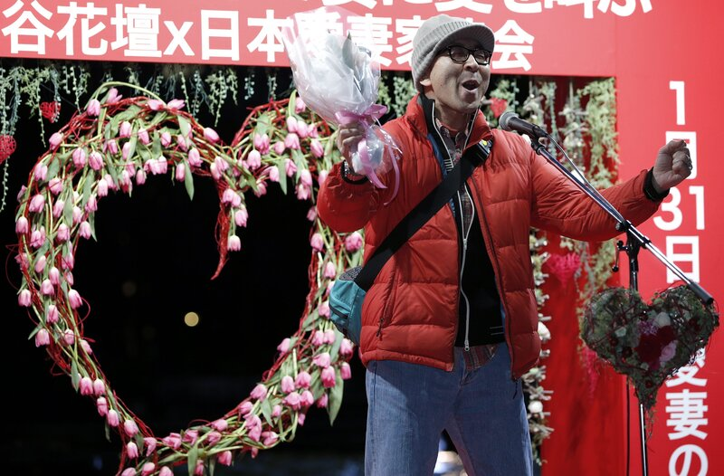 A man shouts his love at an event in Tokyo on Jan. 29. The event comes two days ahead of Beloved Wives Day, a day on which husbands publicly scream their love for their wives before a crowd of onlookers. Husbands are also urged to head home early to express gratitude to their wives.