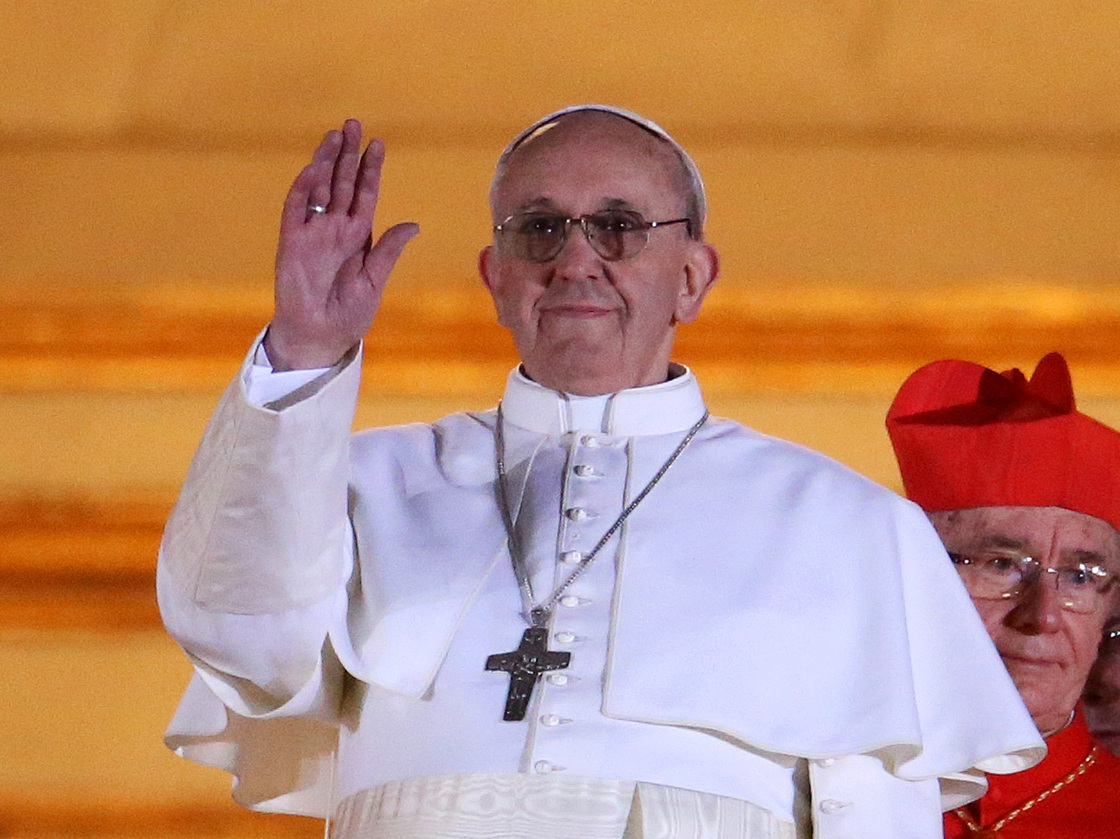 The newly elected Pope Francis (formerly known as opera lover and Argentine Cardinal Jorge Mario Bergoglio) appears on the balcony of St Peter's Basilica on March 13, 2013 in Vatican City.
