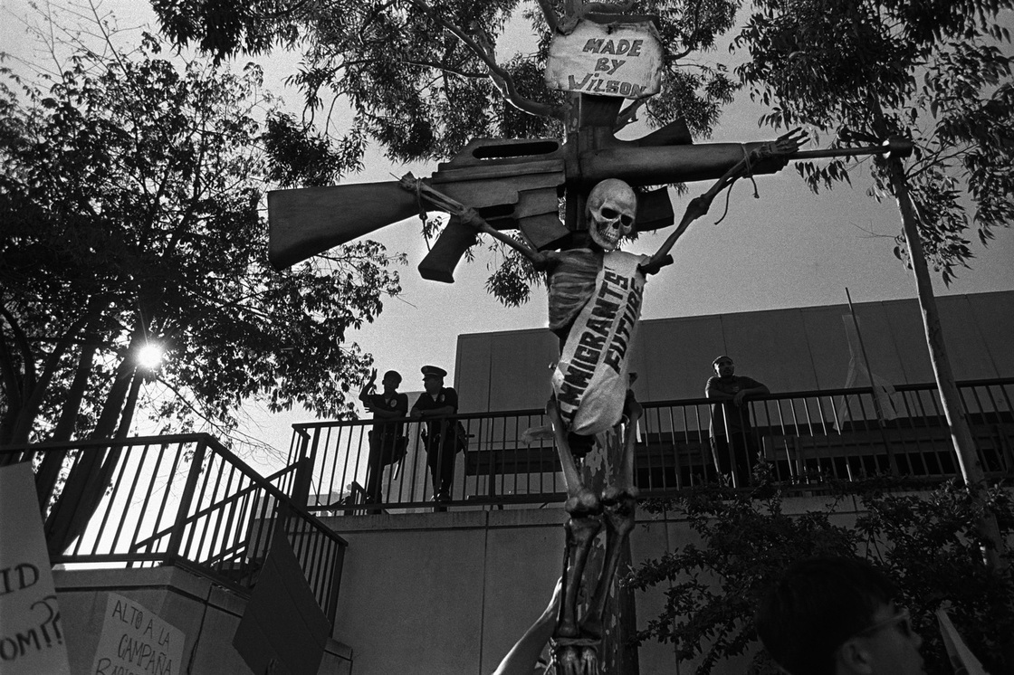 Immigrants protest Proposition 187, a ballot initiative to deny education and health care to adults and children in this country illegally. The initiative was ultimately defeated, but it marked hardening attitudes toward immigrants and their children. Los Angeles, 1994