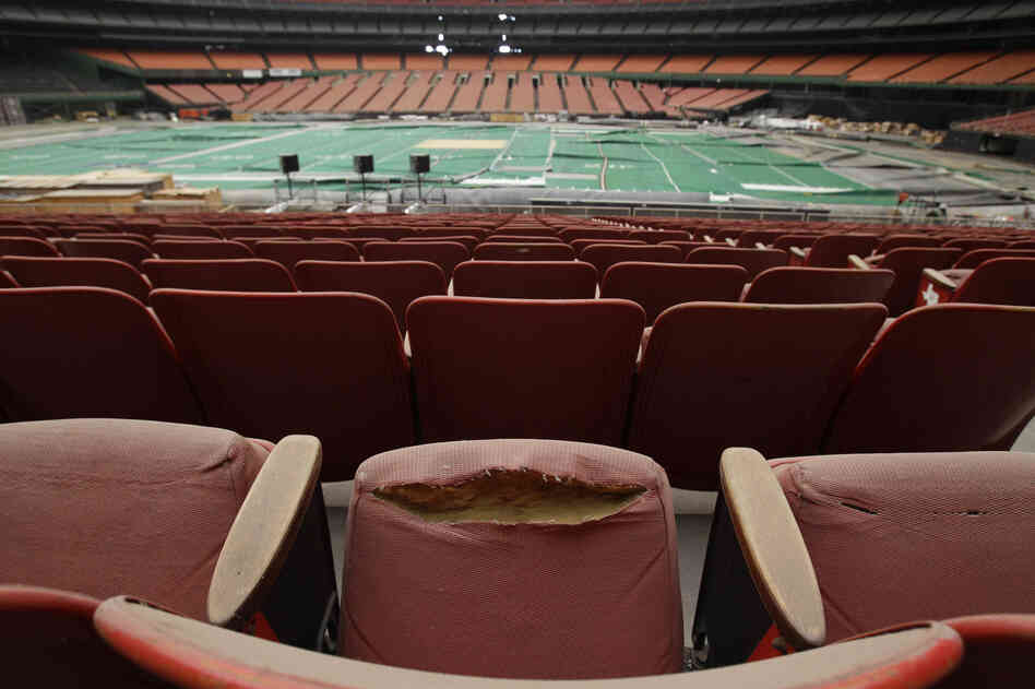 "Rows of dirty, tattered seats ring the Astrodome in Houston in 2012. Once touted as the ""Eighth Wonder of the World,"" the nation's first domed stadium was last used in 2009."