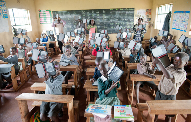 Students at Ntimigom School in Kilgoris, Kenya, show off their e-readers. Worldreader now operates in 27 schools and two libraries in Kenya.