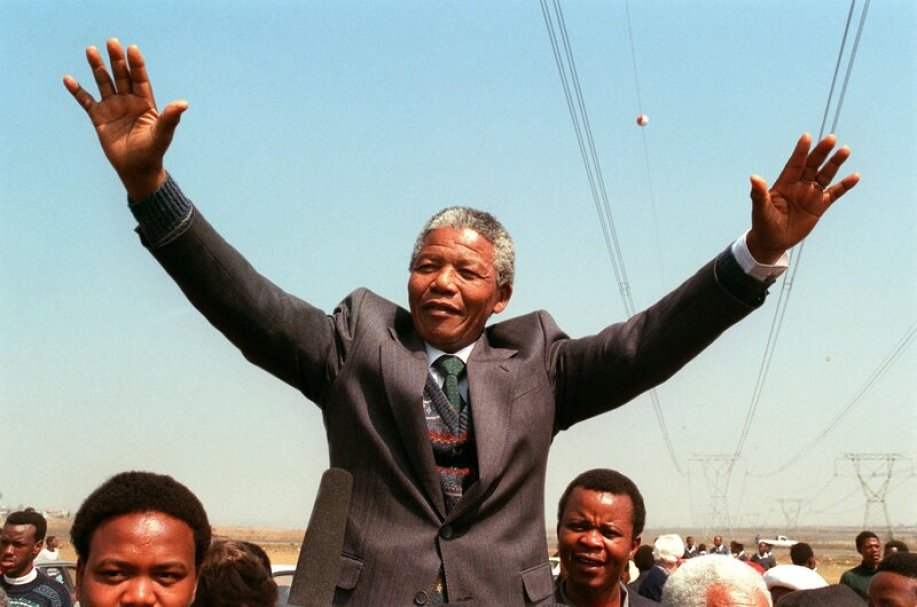 Nelson Mandela with hands in the air