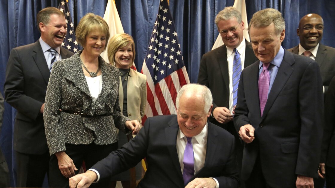 Illinois Gov. Pat Quinn smiles during the signing of the pension overhaul legislation bill on Dec. 5 in Chicago. Looking on from left are: Sen. Bill Brady, R-Bloomington; Senate GOP leader Sen. Christine Radogno; Rep. Darlene Senger, R-Naperville; Rep. Jim Durkin, R-Western Springs; House Speaker Michael Madigan and Sen. Kwame Raoul, D-Chicago.