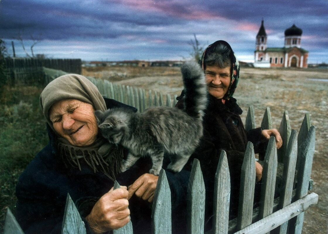 A kitten loves on an old woman in the Cossack village of Velikopetrovskaya near Cheliyabinsk.