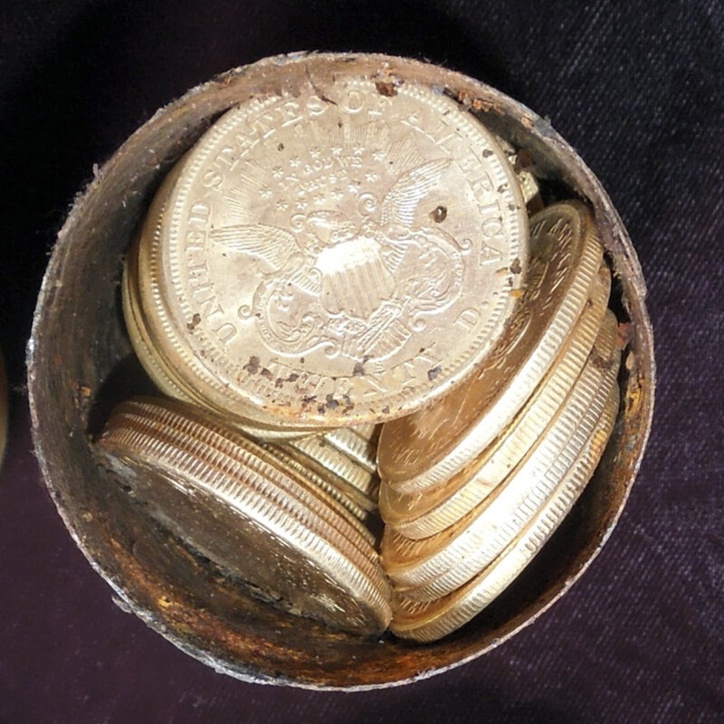 Thar's gold in them thar cans: One of the eight cans discovered by a California couple. They were stuffed with gold coins minted in the 1800s. The cache's estimated value: $10 million.