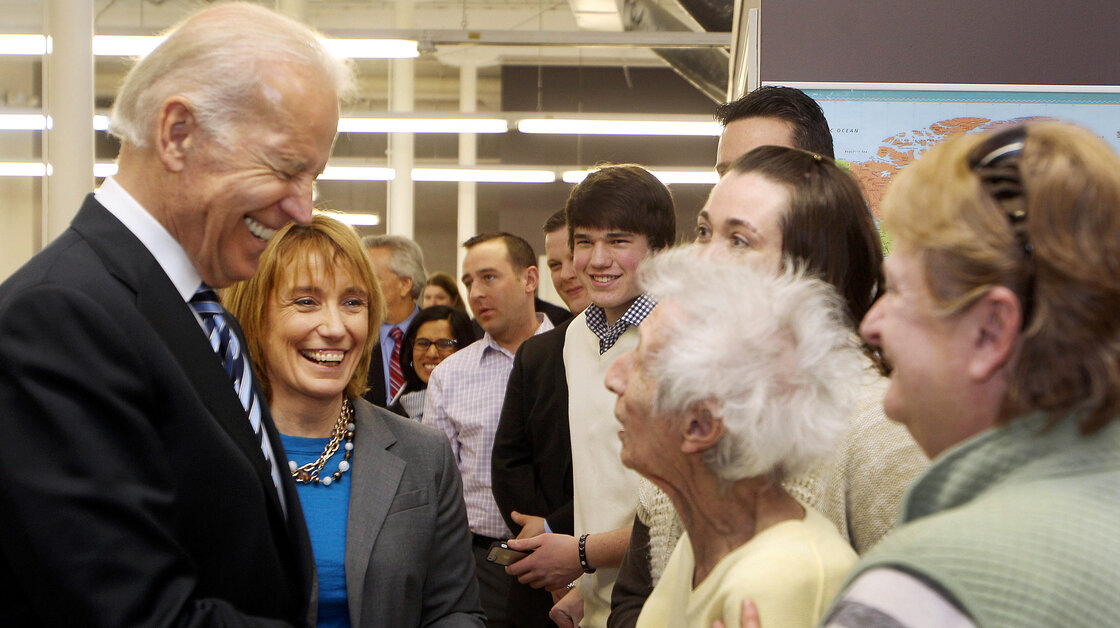 Vice President Joe Biden, accompanied by New Hampshire Gov. Maggie Hassan, greets Enis Sullivan, 101, during his visit to XMA Corp. on March 25 in Manchester, N.H.