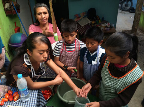 Children learn to cook at Prodesenh, a community center in San Mateo Milpas Altas, Guatemala.