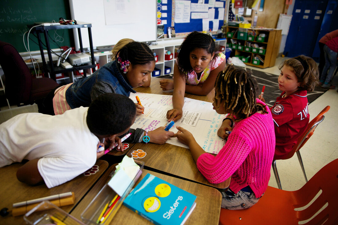Fifth-graders discuss the meanings of difficult words during a Common Core-inspired reading lesson.