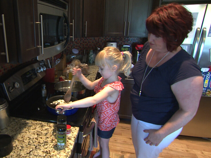 Sherri Erkel, right, and her daughter, Asa, cook dinner in their kitchen in Iowa City, Iowa. The Erkel family is part of an EPA study measuring the amount of food wasted in U.S. homes.