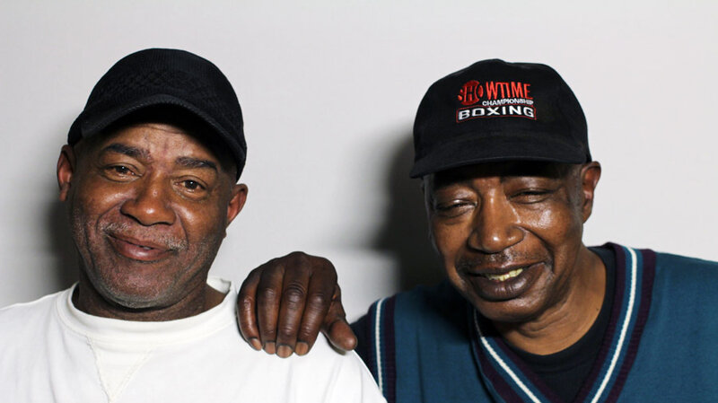 Herman Travis (L) with his friend, Robert Cochran (R) at StoryCorps in San Francisco. Travis delivers groceries from a local food bank to his elderly neighbors, like Cochran.