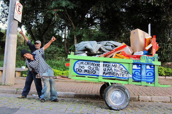 "Trash pickers collect 90 percent of waste that gets recycled in Brazil yet local governments give them little support. The message on this cart: ""One catadore does more than an environmental minister."""