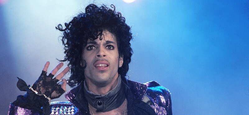 Prince performs on stage during the Purple Rain tour in 1984.