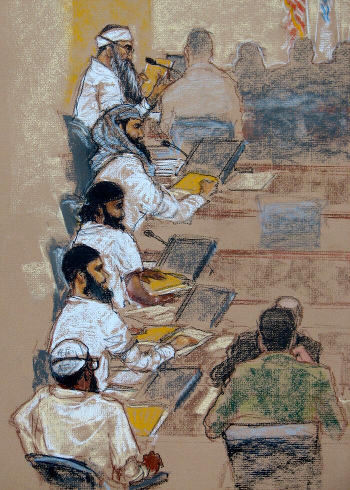 In this photo of a sketch by court artist Janet Hamlin, (top to bottom) Khalid Sheik Mohammed, Walid bin Attash, Ramzi bin al-Shibh, Ammar al-Baluchi, and Mustafa al-Hawsawi attend a hearing at the U.S. Military Commissions court for war crimes at the U.S. Naval Base in Guantanamo Bay, Cuba, in Jan. 2009.