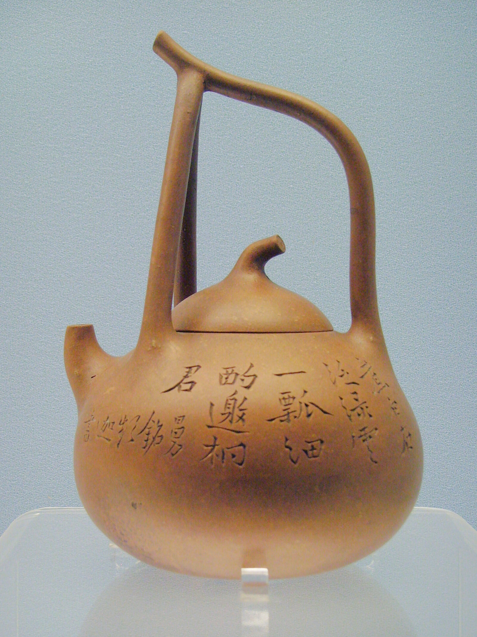 A Yi-Xing teapot made circa 1900. The first teapots came from the Yi-Xing region of China. Japanese potters moved the handle from the side to the top of the teapot, a style that later made its way back to China.