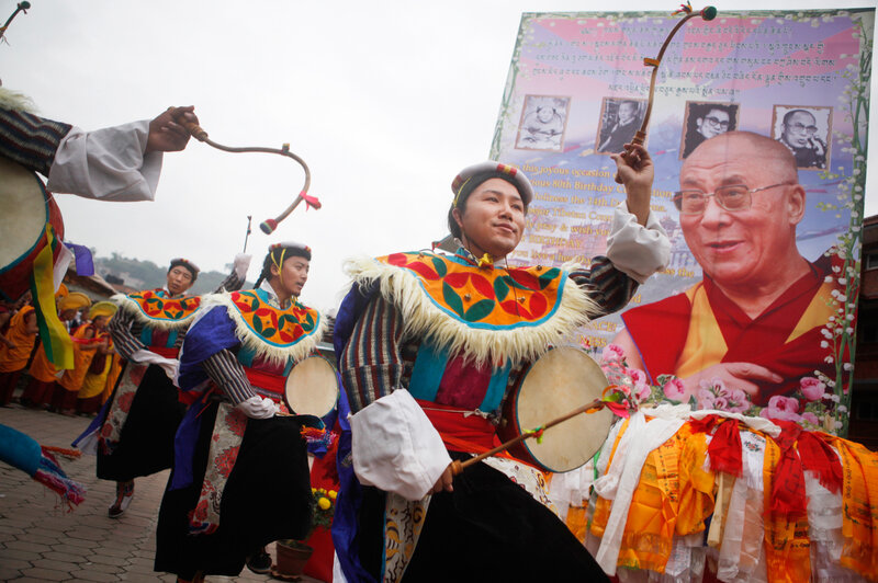 On July 6, Tibetan men living in Kathmandu, Nepal, danced during celebrations to mark the 80th birthday of the Dalai Lama.