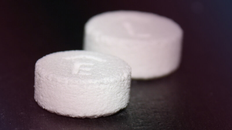 A product image provided by Aprecia Pharmaceuticals shows Spritam 750 mg (foreground) and 1,000 mg tablets. The 3-D-printed pills have been approved by the FDA.