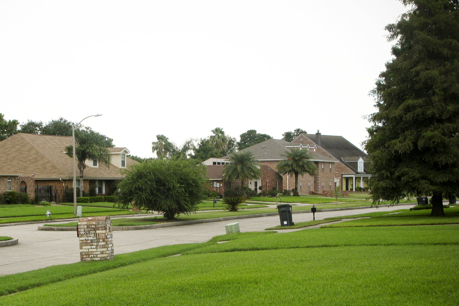 Large homes and lush lawns are common in Lake Forest Estates, a subdivision in New Orleans East. After Katrina, 6-foot-deep flood waters devastated the region.