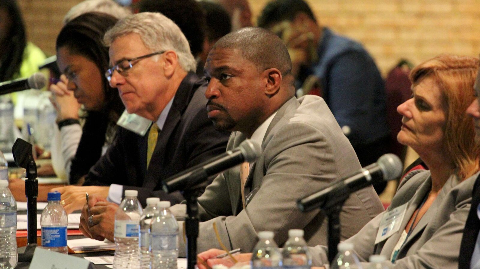 Members of the Ferguson Commission, including co-chairman Starsky Wilson, second from right, listen at a recent hearing of the Ferguson Commission. After months of deliberation, the commission is releasing a report laying bare racial and economic inequalities in the St. Louis region, and calling for change.