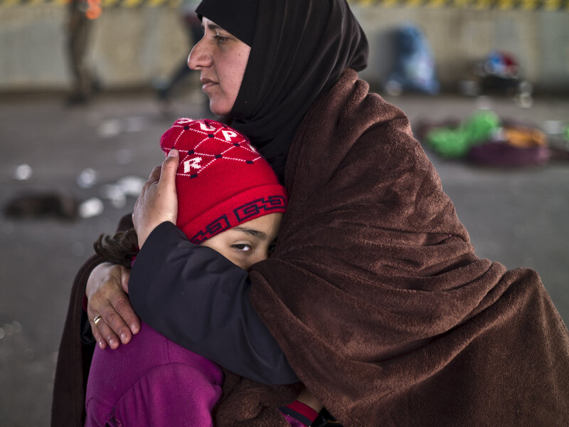 A Syrian refugee mother comforts her daughter after they spent the night in a parking lot on the Austrian side of the Hungarian-Austrian border. More than 4 million Syrians have fled the civil war in their devastated homeland, and such crises can take decades to resolve.