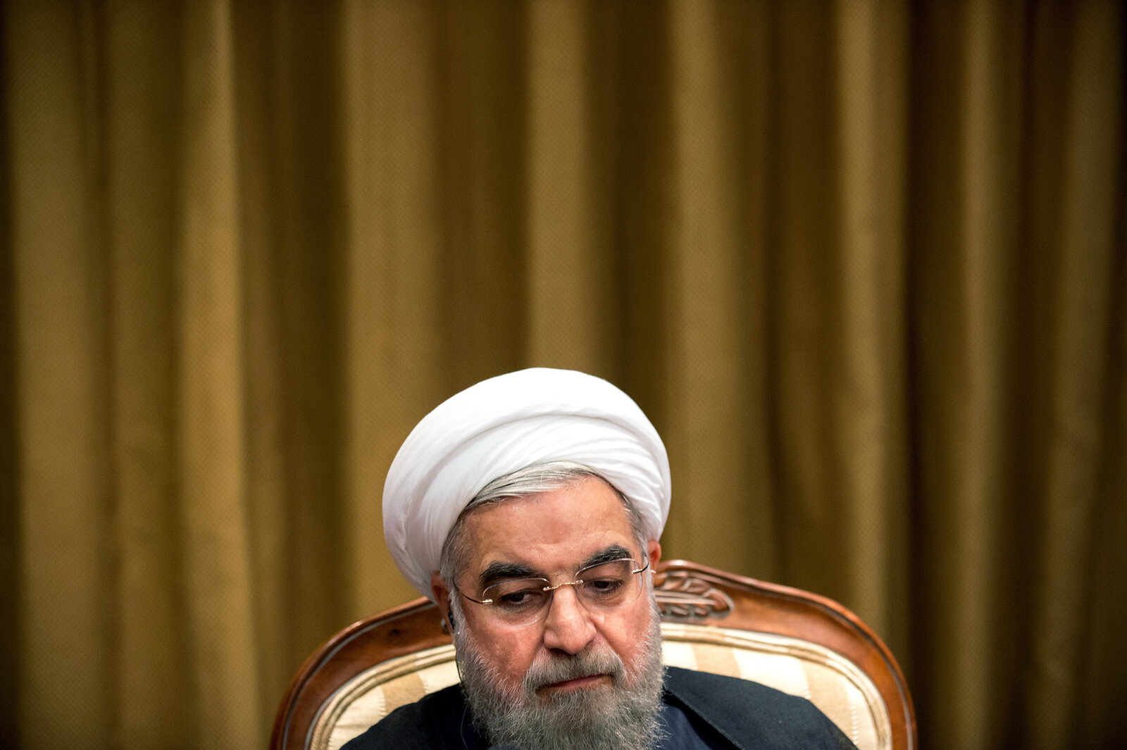 Iranian President Hassan Rouhani prepares to speak with NPR's Steve Inskeep on Saturday in New York. Rouhani reaffirmed Iran's commitment to the nuclear deal and said his country would be willing to discuss Syria's future with the United States — after ISIS is defeated.