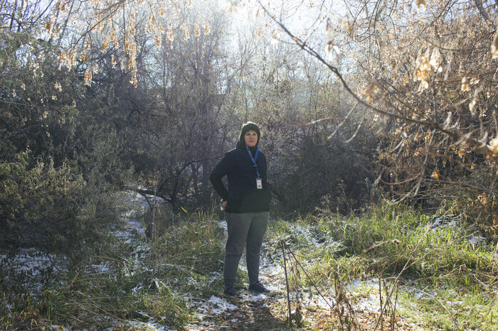 Volunteers of America outreach employee Sanela Piragic poses for a portrait near a homeless encampment in South Salt Lake.