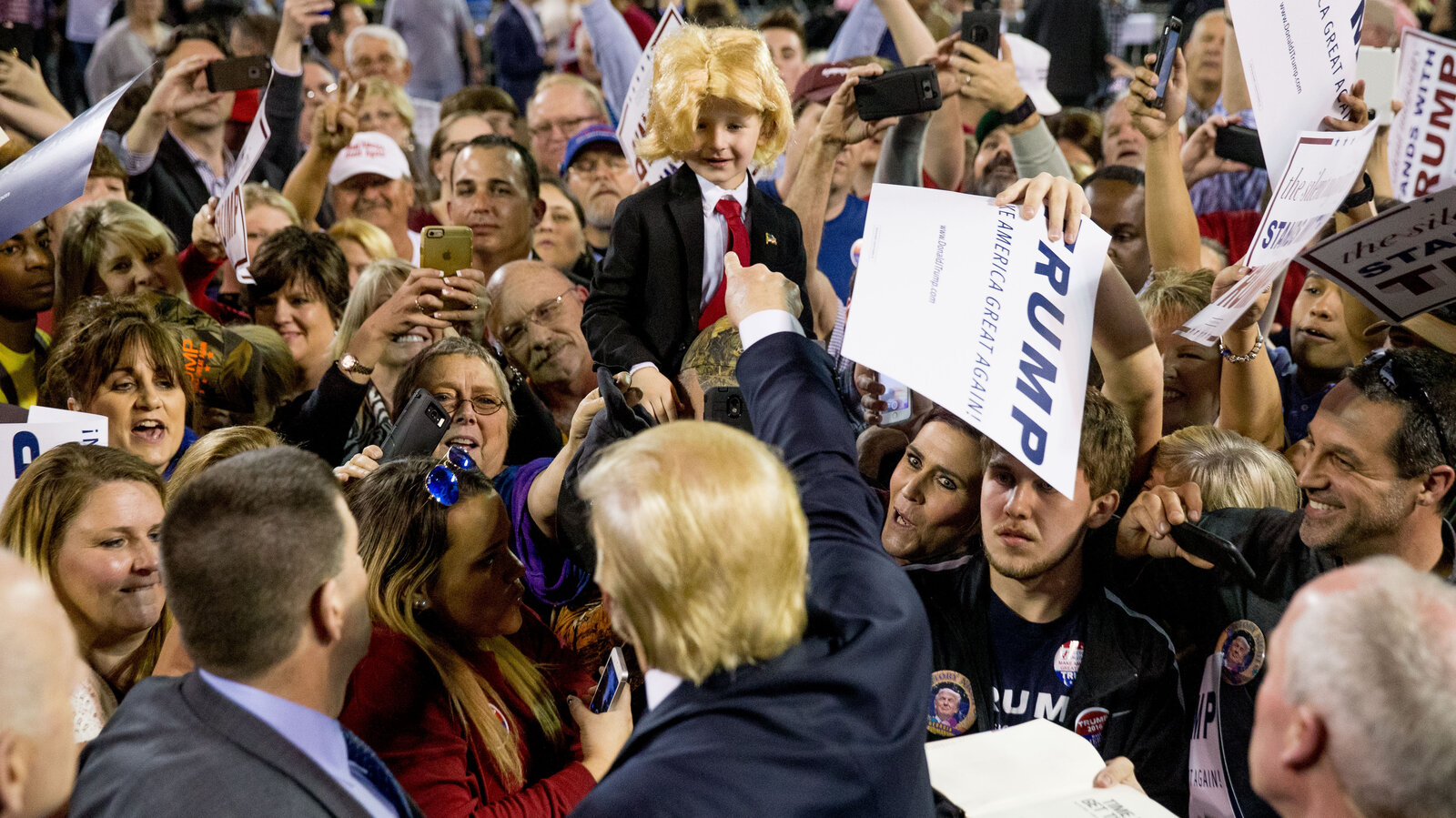 Republican presidential candidate Donald Trump acknowledges his lookalike Colton Jordan, 5, of Cario, Ga., after a rally at Valdosta State University in Georgia on Monday.