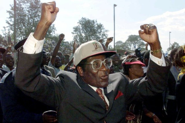 Zimbabwe President Robert Mugabe in Zimbabwe in 2000, on the eve of the country's national elections.