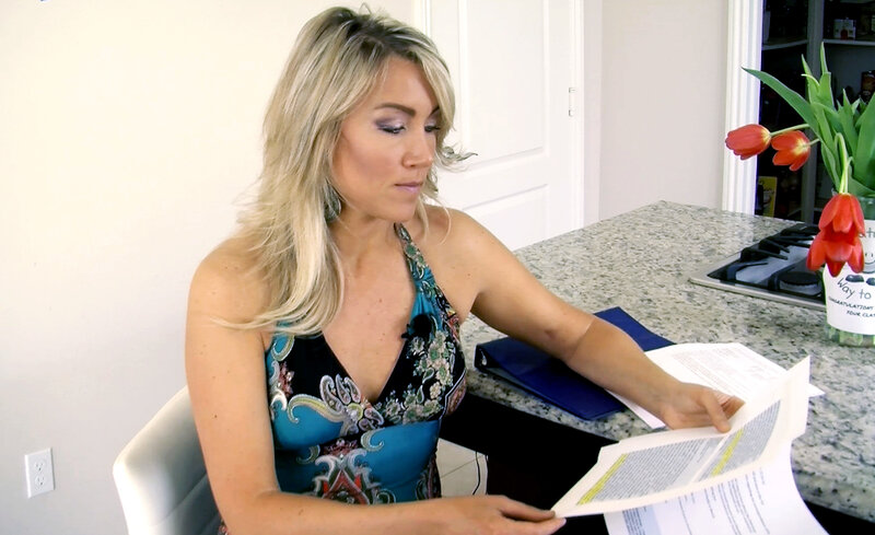 Navy veteran Amanda Wirtz looks through her correspondence with the Veteran's Choice program. After the VA couldn't get her an appointment with a specialist, it sent her to the Choice program. But it still took several months for her to get an appointment.