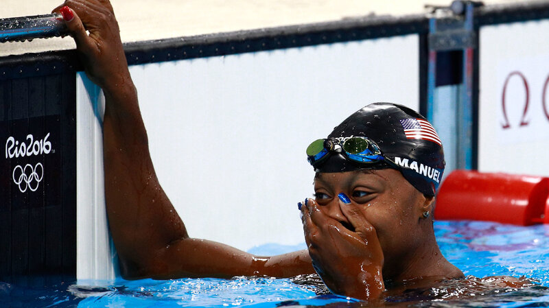 Simone Manuel of the United States celebrates after winning gold in the women's 100-meter freestyle at the Rio 2016 Summer Olympics.