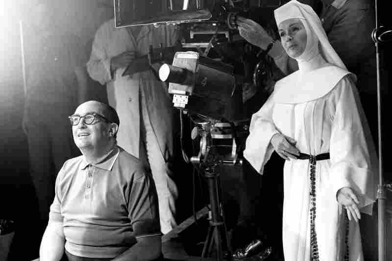 Debbie Reynolds, dressed as nun for her role as a nun in the film The Singing Nun, practices her next scene while she watches another scene being filmed in November 1965.
