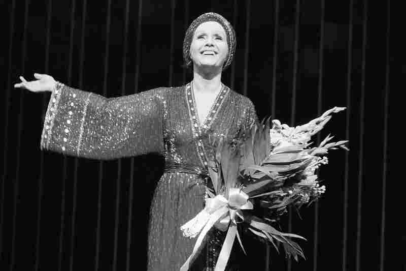 Debbie Reynolds takes the stage for a curtain call after a performance of Woman of the Year at New York's palace theatre on March 8, 1983. Miss Reynolds returned to the show after having collapsed on stage during a matinee on March 5.