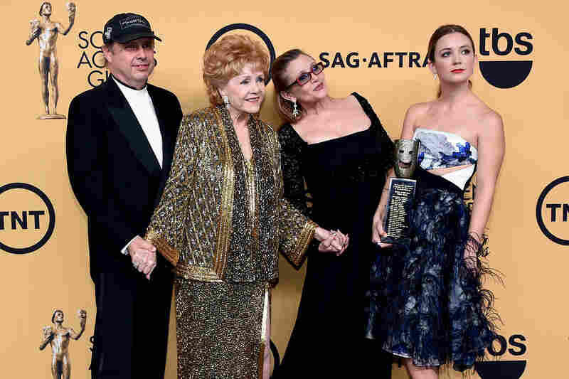 Debbie Reynolds, poses for a photo with her son, Todd Fisher (left), daughter Carrie Fisher, and granddaughter Billie Lourd (far right) after Reynolds received the Screen Actors Guild Life Achievement Award in 2015.